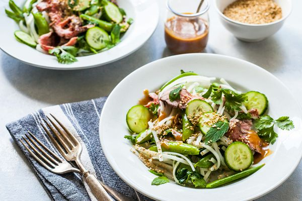 Beef Noodle Bowl - - noodle salad with beef and vegtables in a white bowl