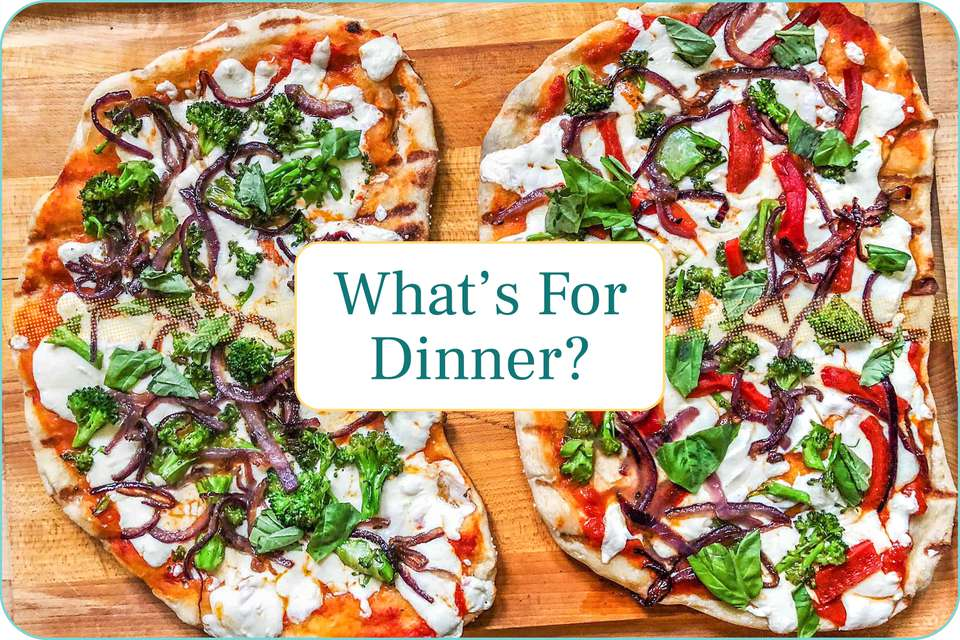 """""""What's for Dinner?"""" with grilled pizzas set behind the caption."""
