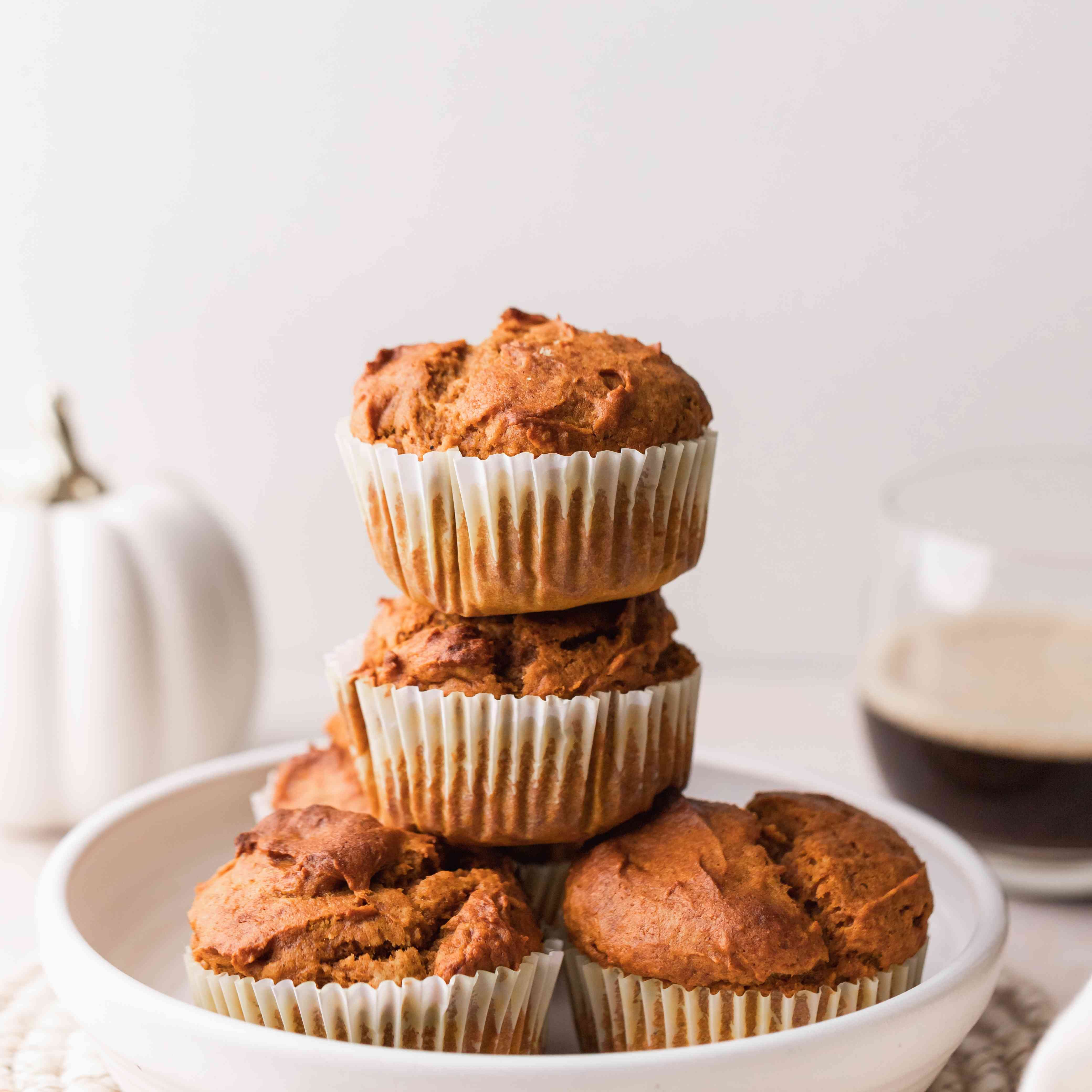 Quick and easy pumpkin muffins stacked in a serving bowl.