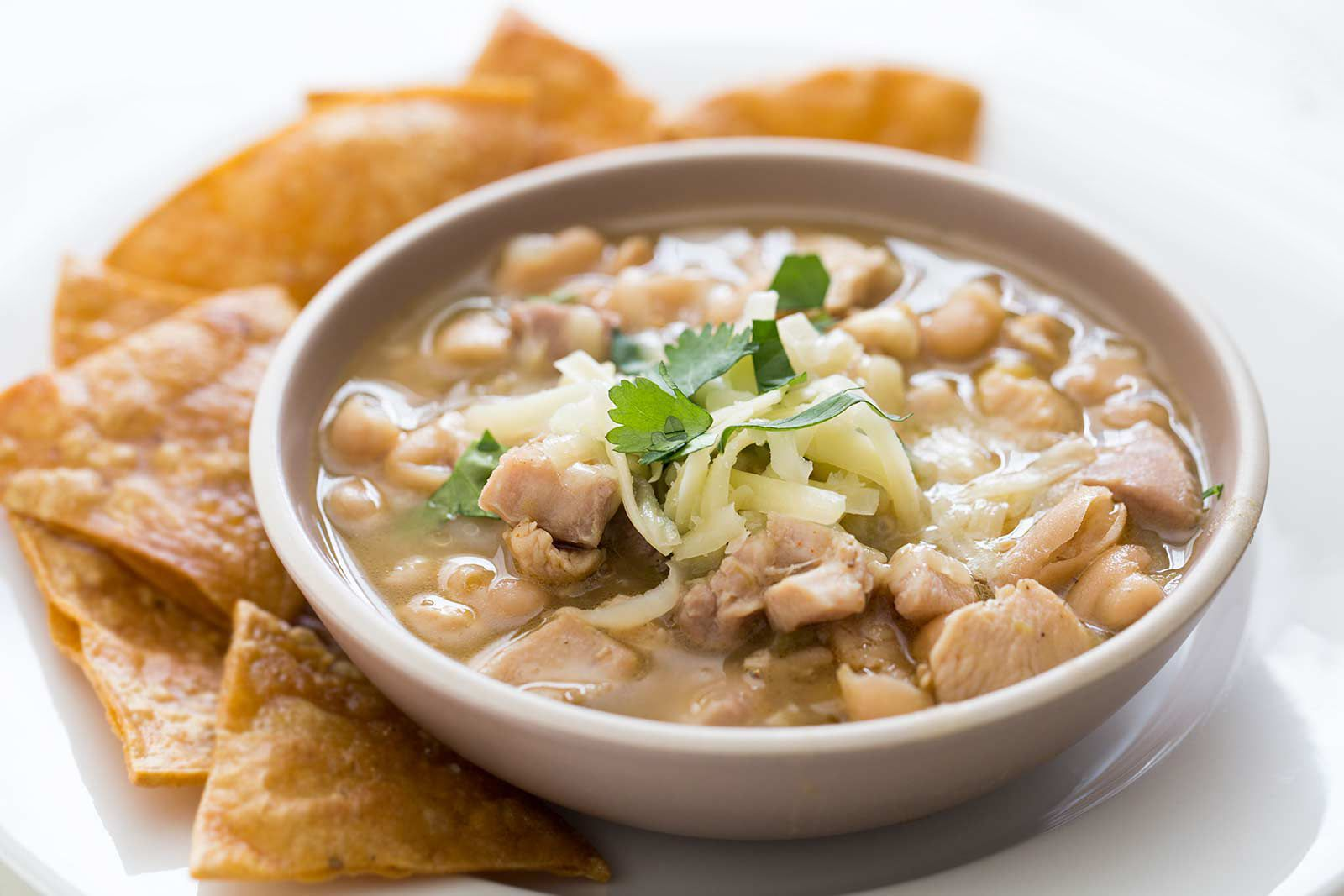 White bean chicken chili in a serving bowl with chips