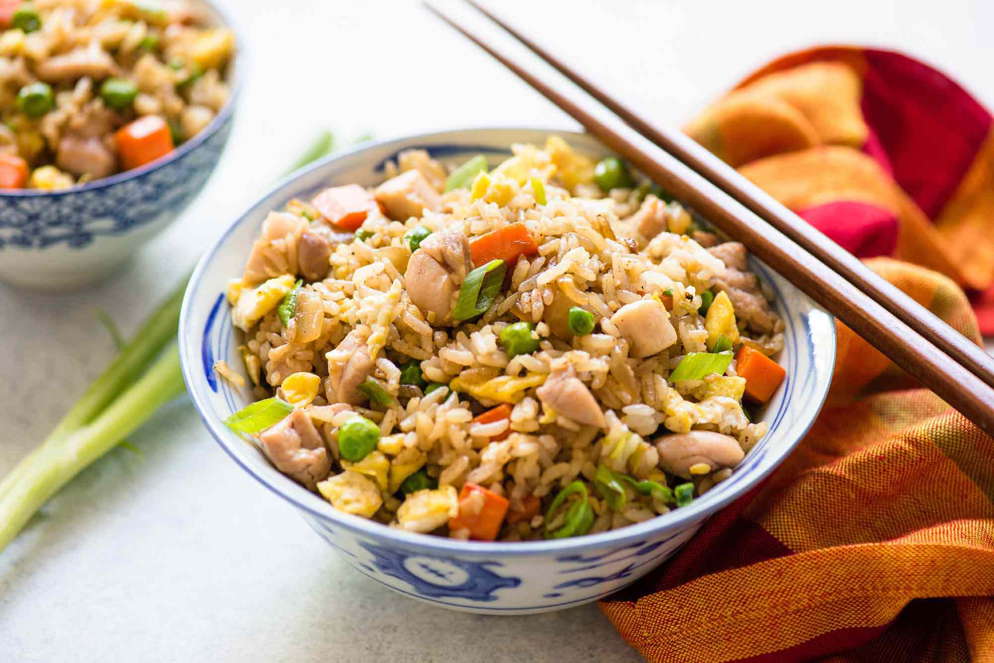 Chicken Fried Rice recipe in a bowl with chopsticks
