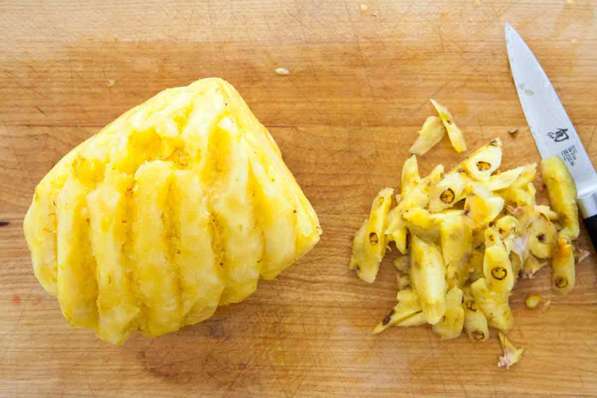 a cut pineapple with eyes removed, ready to slice