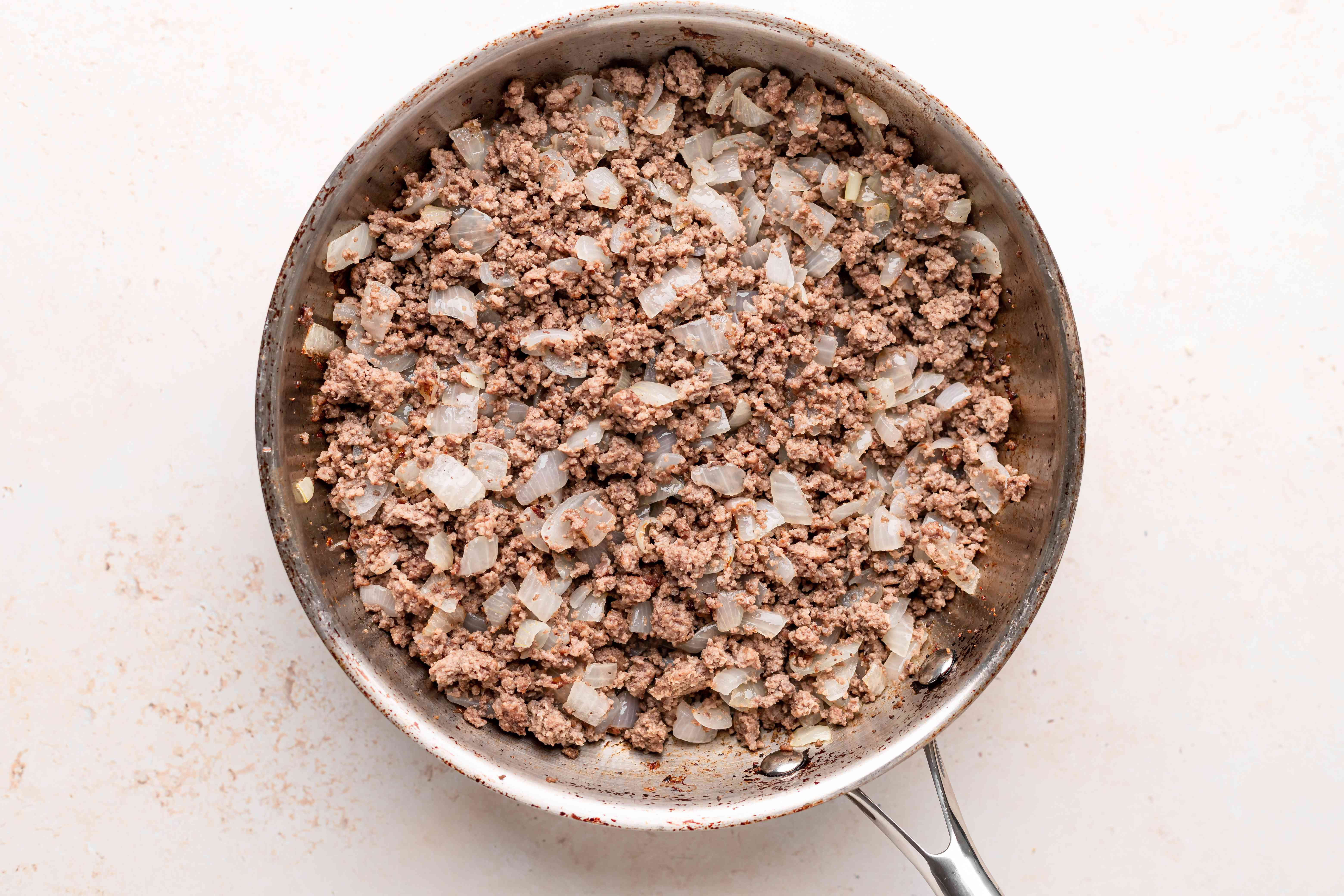 Browned beef for a baked ziti recipe.