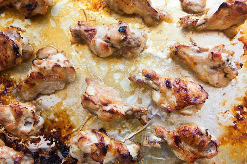 ginger honey chicken wings on baking sheet