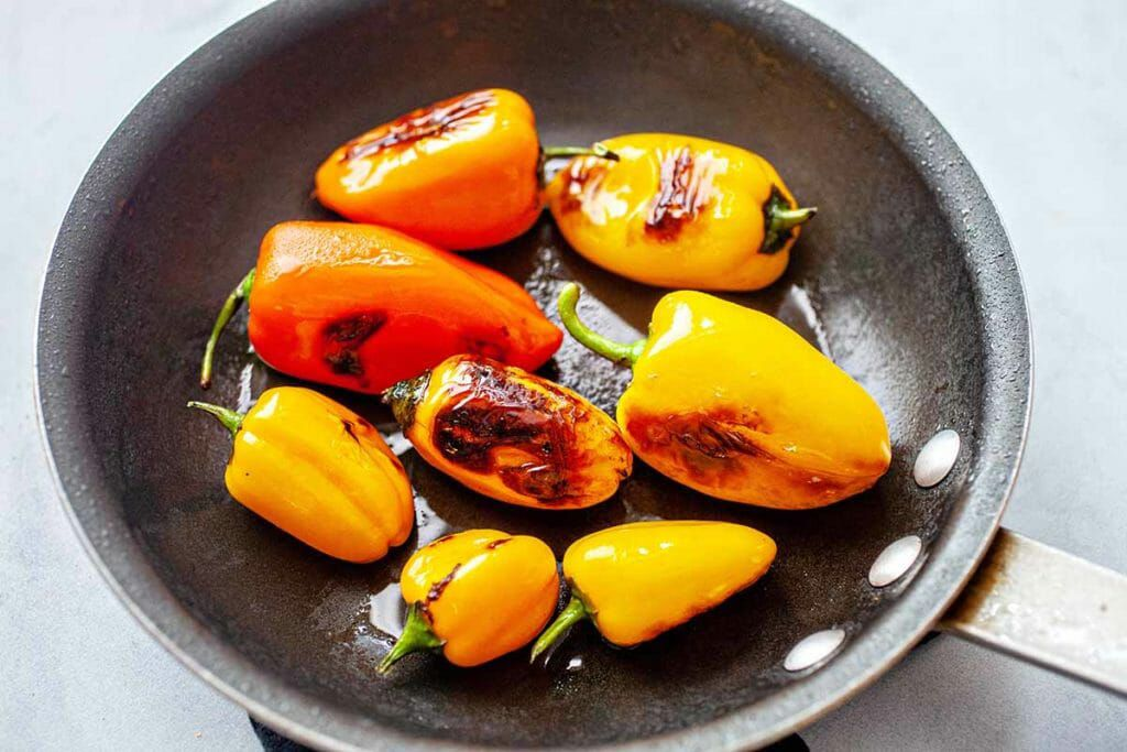 Summer Panzanella Salad - blistering peppers in pan