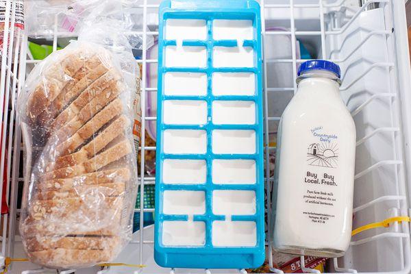 Milk bottle ice cube tray bread in freeze