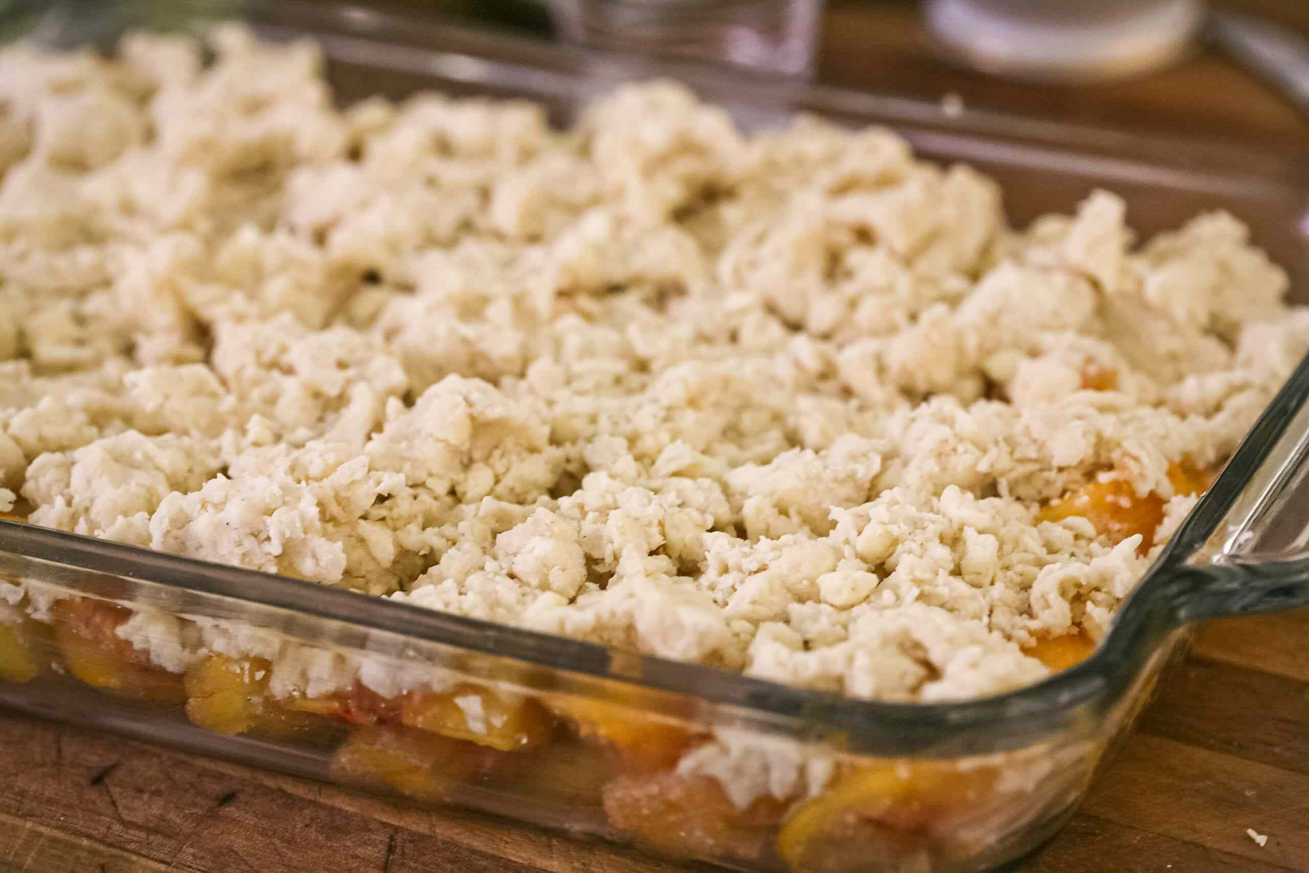 Easy peach cobbler topped with crumbled biscuit topping