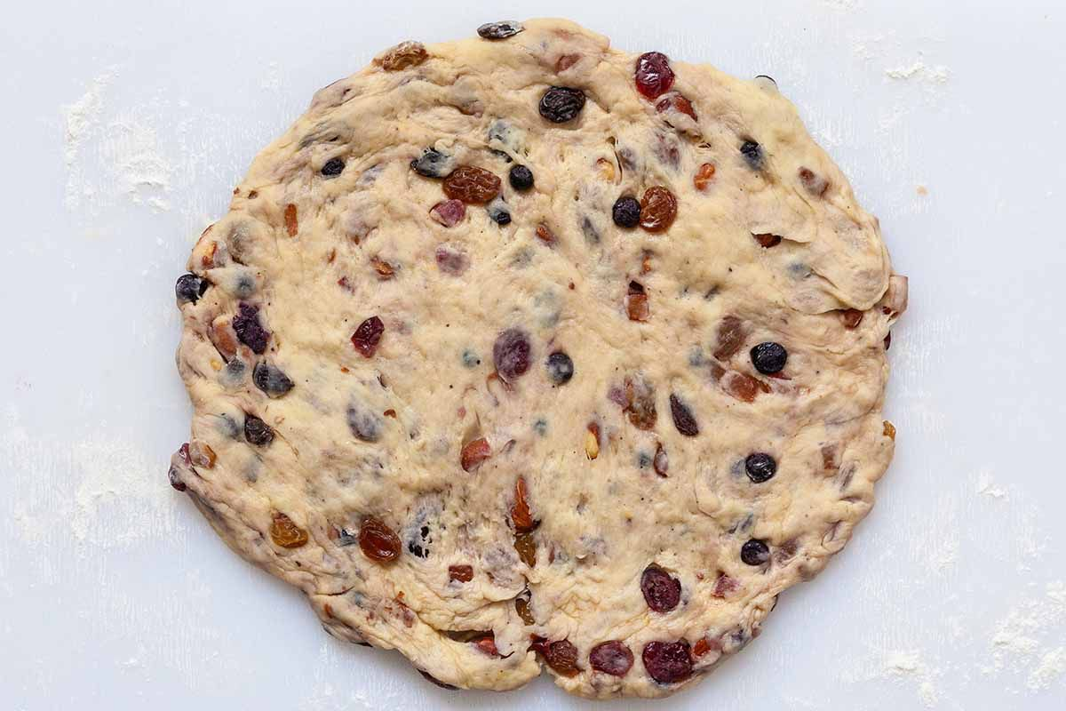 Stollen Christmas Bread dough filled with rum-soaked dried fruit and patted into a round.