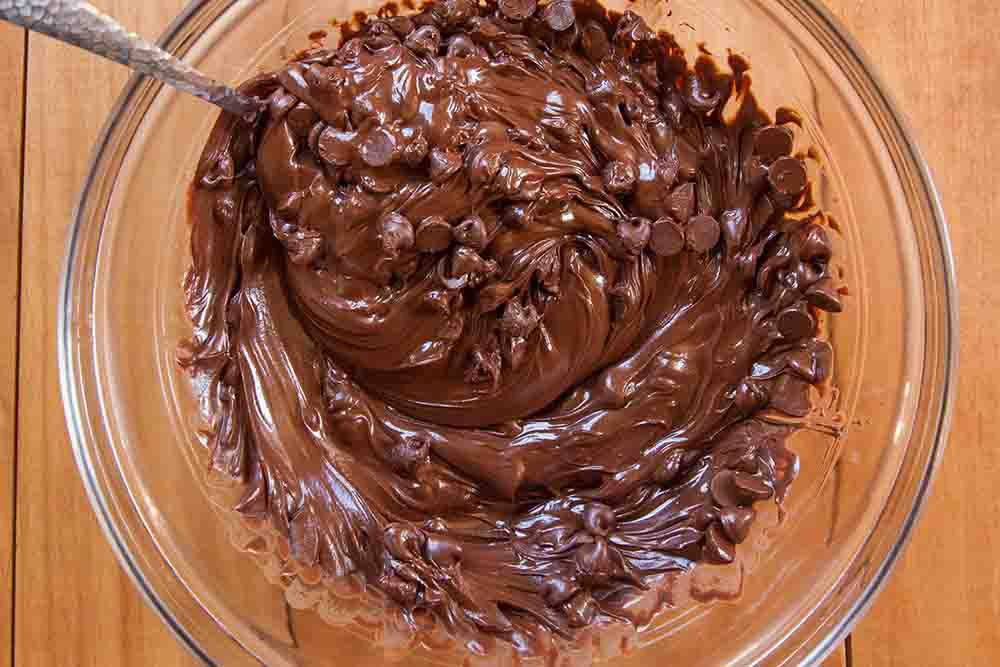Melting chocolate for peanut butter balls recipe.