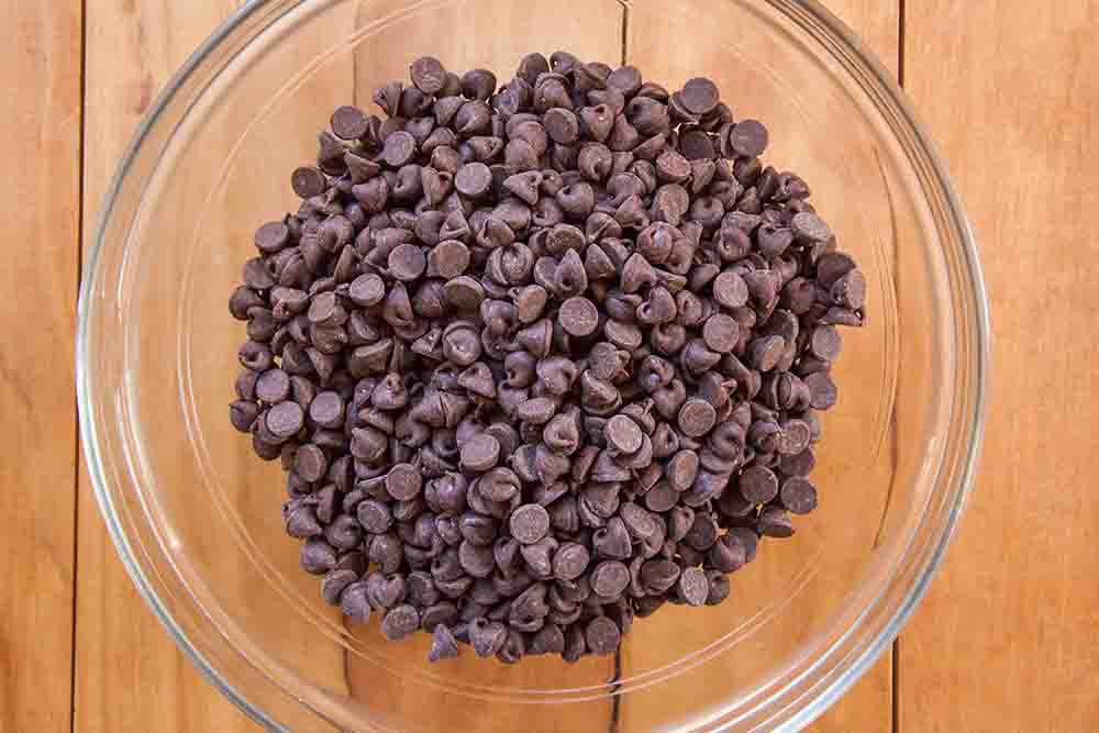 Chocolate chips in a glass bowl for a buckeye recipe.