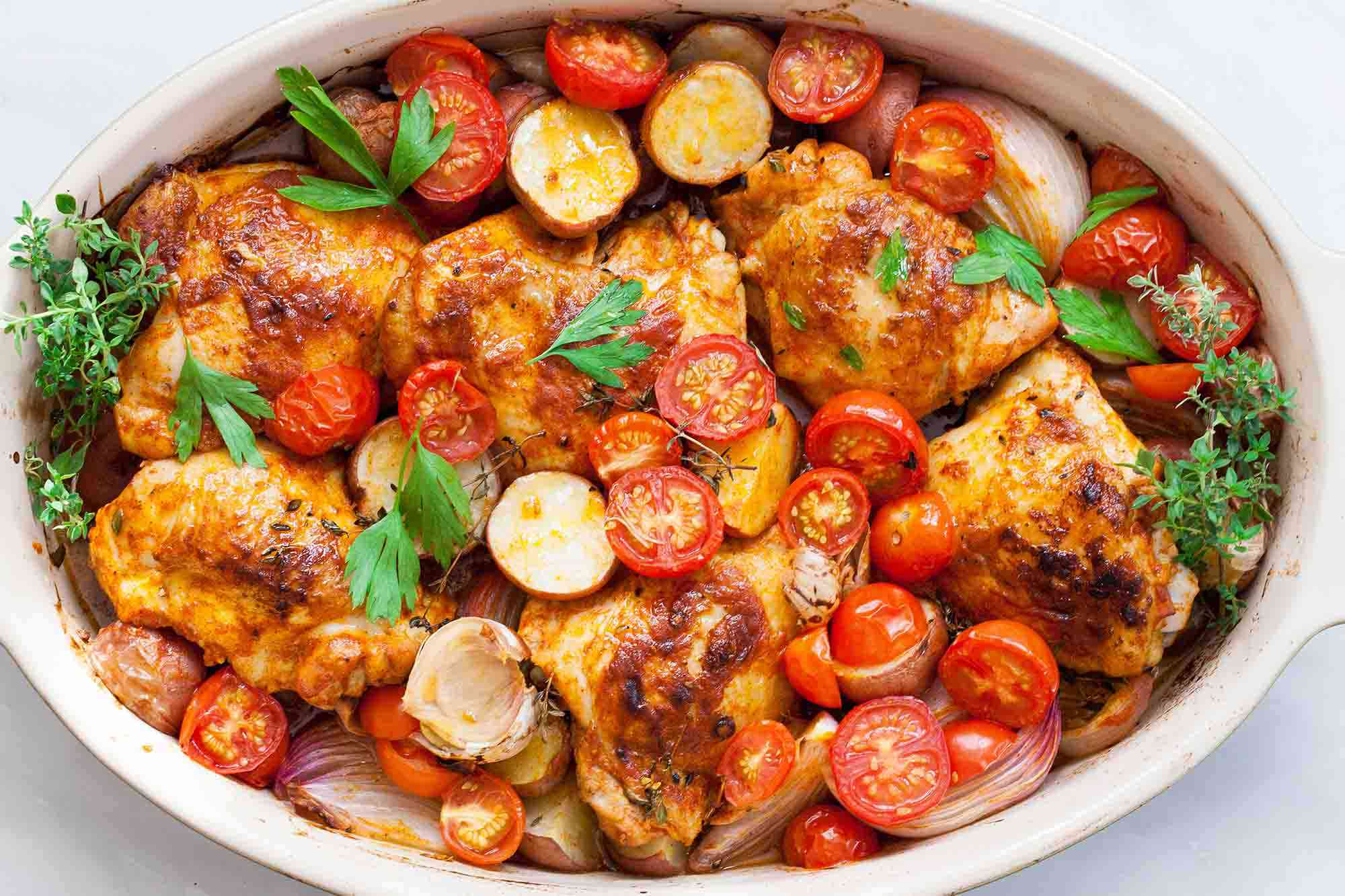 Paprika Chicken and Potatoes with Tomatoes horizontal in a baking dish