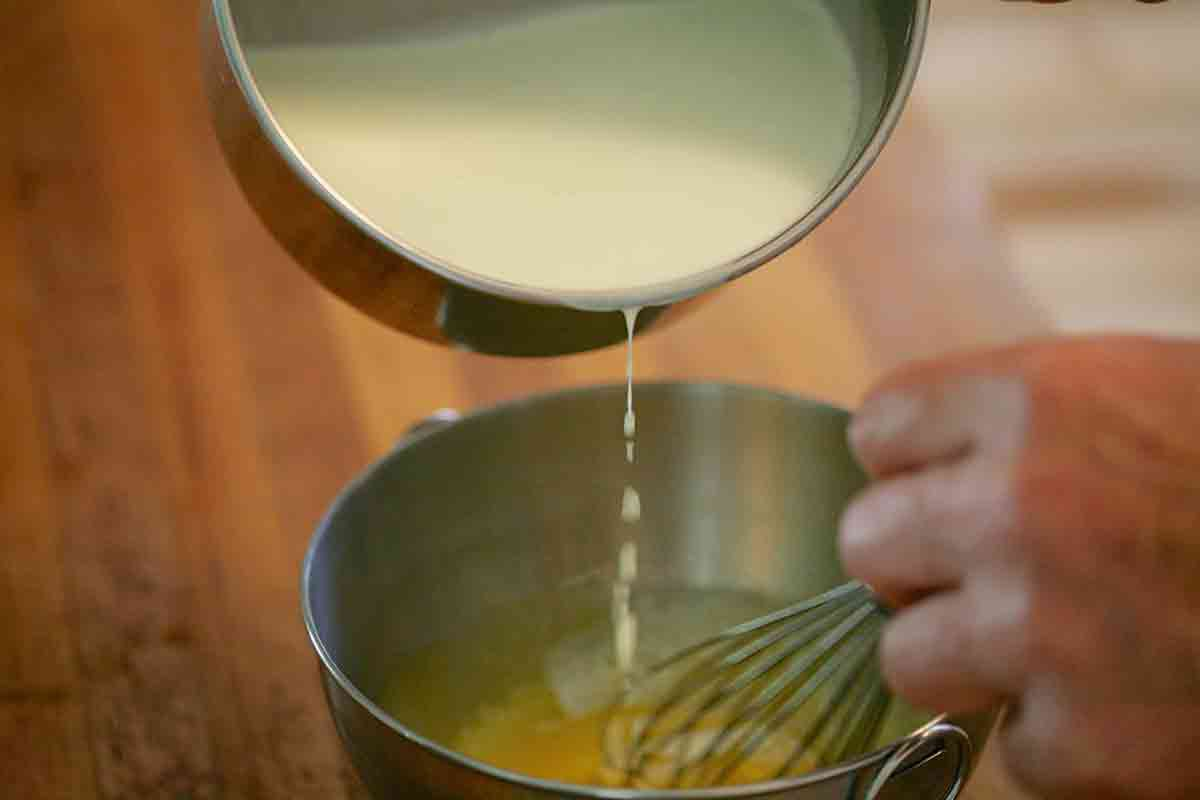 Warm Egg Yolks Being Poured into Sauce Pan