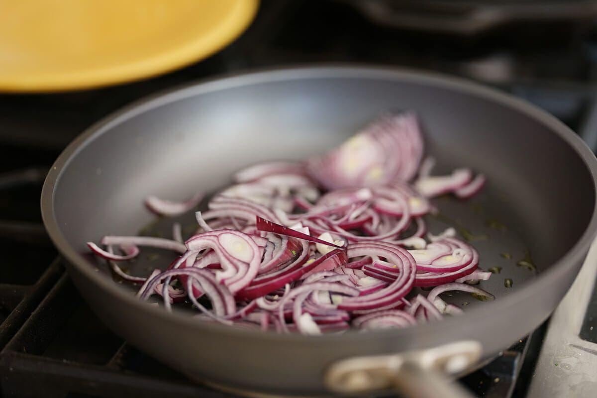 Avocado black bean quesadillas cook the red onion