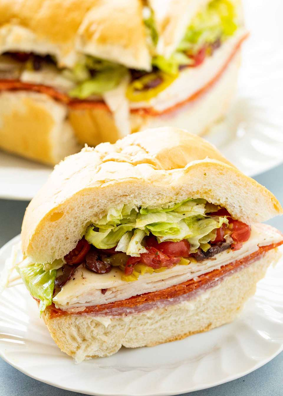 Italian sandwich for a crowd with the meat, cheese and toppings visible.