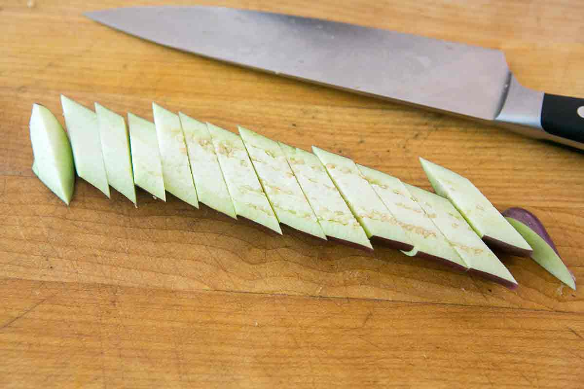 slice japanese eggplant to prepare for stir fry