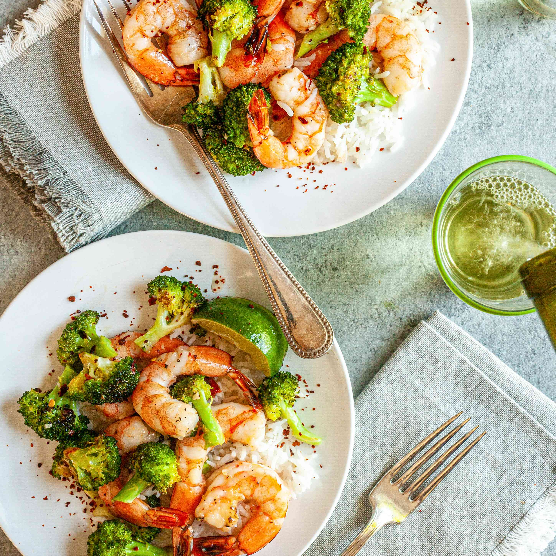 Sheet Pan Hot Honey Roasted Shrimp and Broccoli on two white plates.