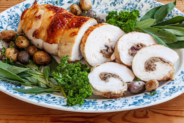 Turkey breast stuffed and sliced on a platter.