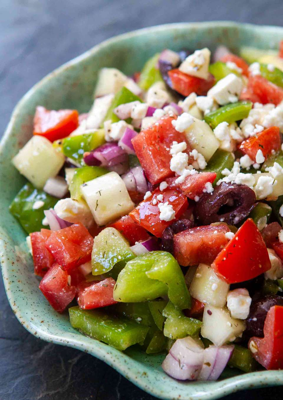 Easy Greek Salad with tomatoes, cucumbers, onions, bell peppers, olives, and feta cheese