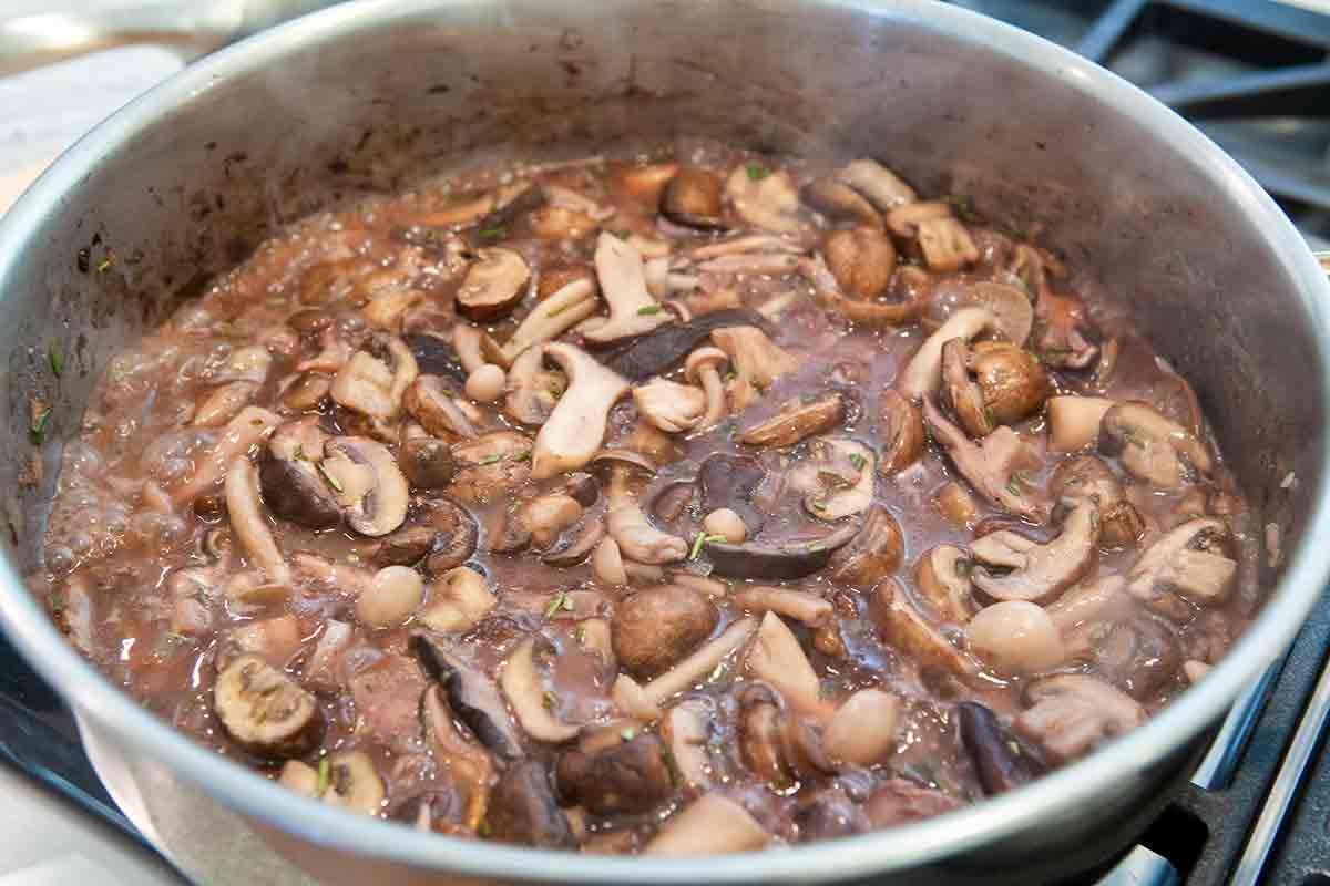 mushrooms in red wine in pan