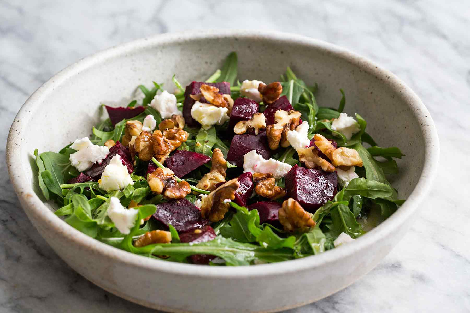 Arugula Salad with Beets and Goat Cheese in a bowl