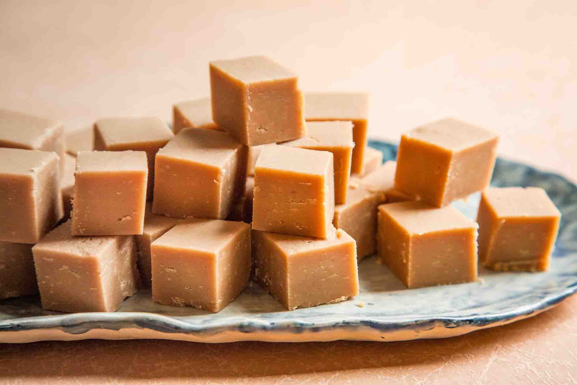 Best Peanut Butter Fudge stacked on a serving tray