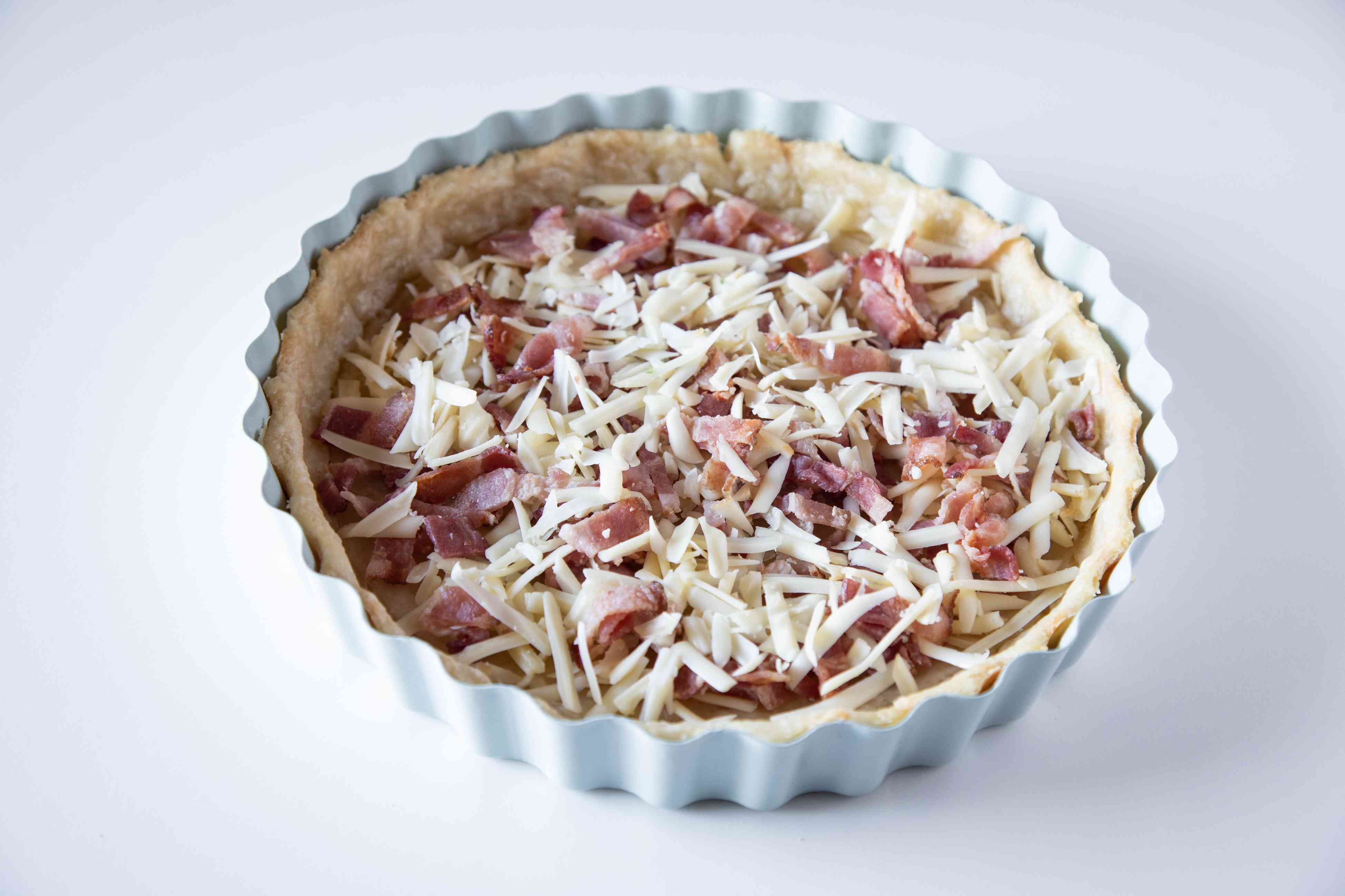 An easy quiche recipe with bacon and cheese added to the crust.
