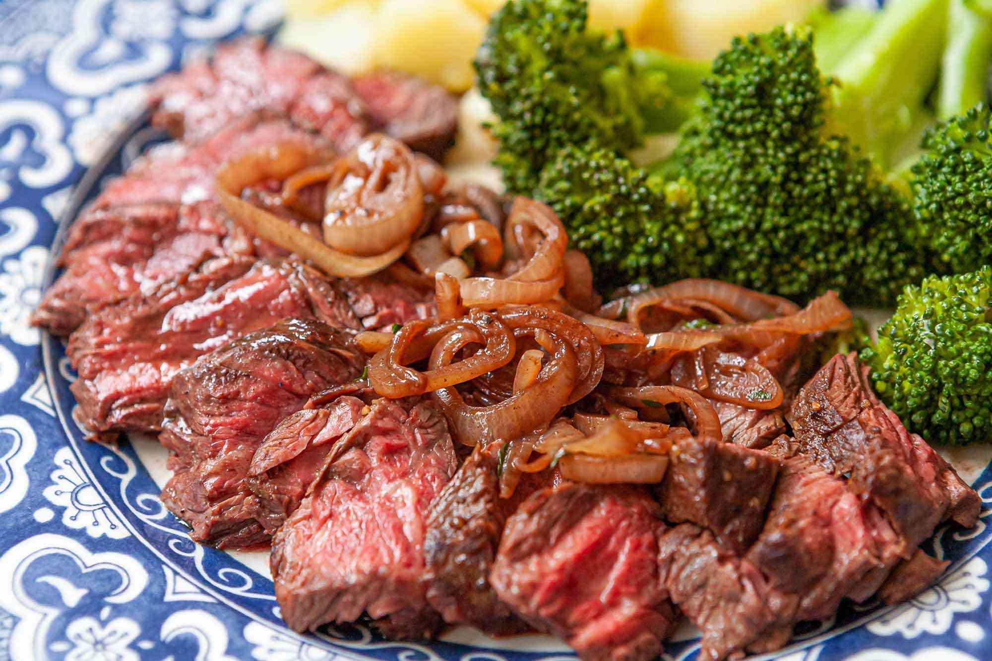 Stovetop Hanger Steak with shallots on a platter for serving