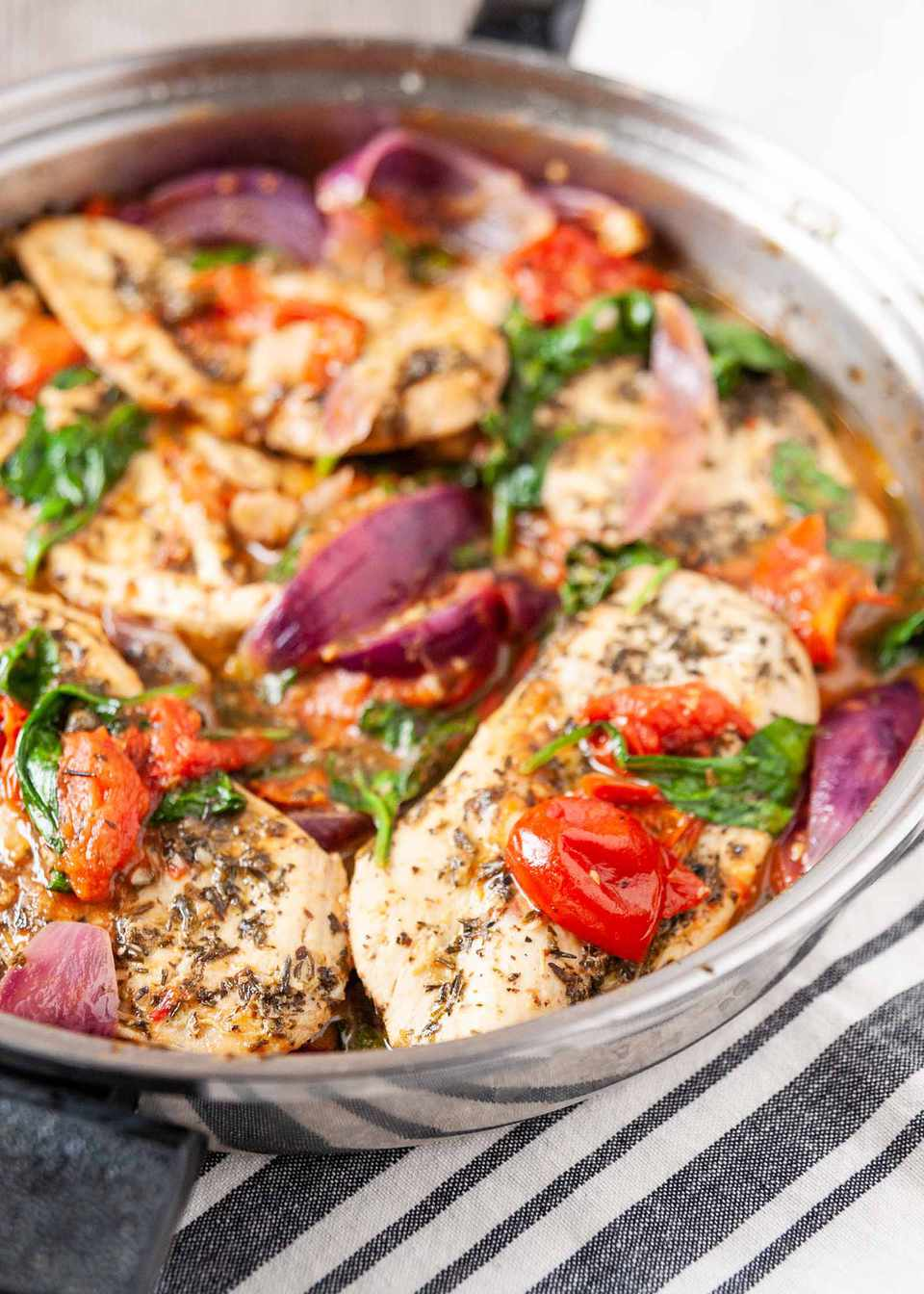 Chicken Recipe in Skillet with Italian Seasonings-close up of chicken and vegetables in a silver skillet