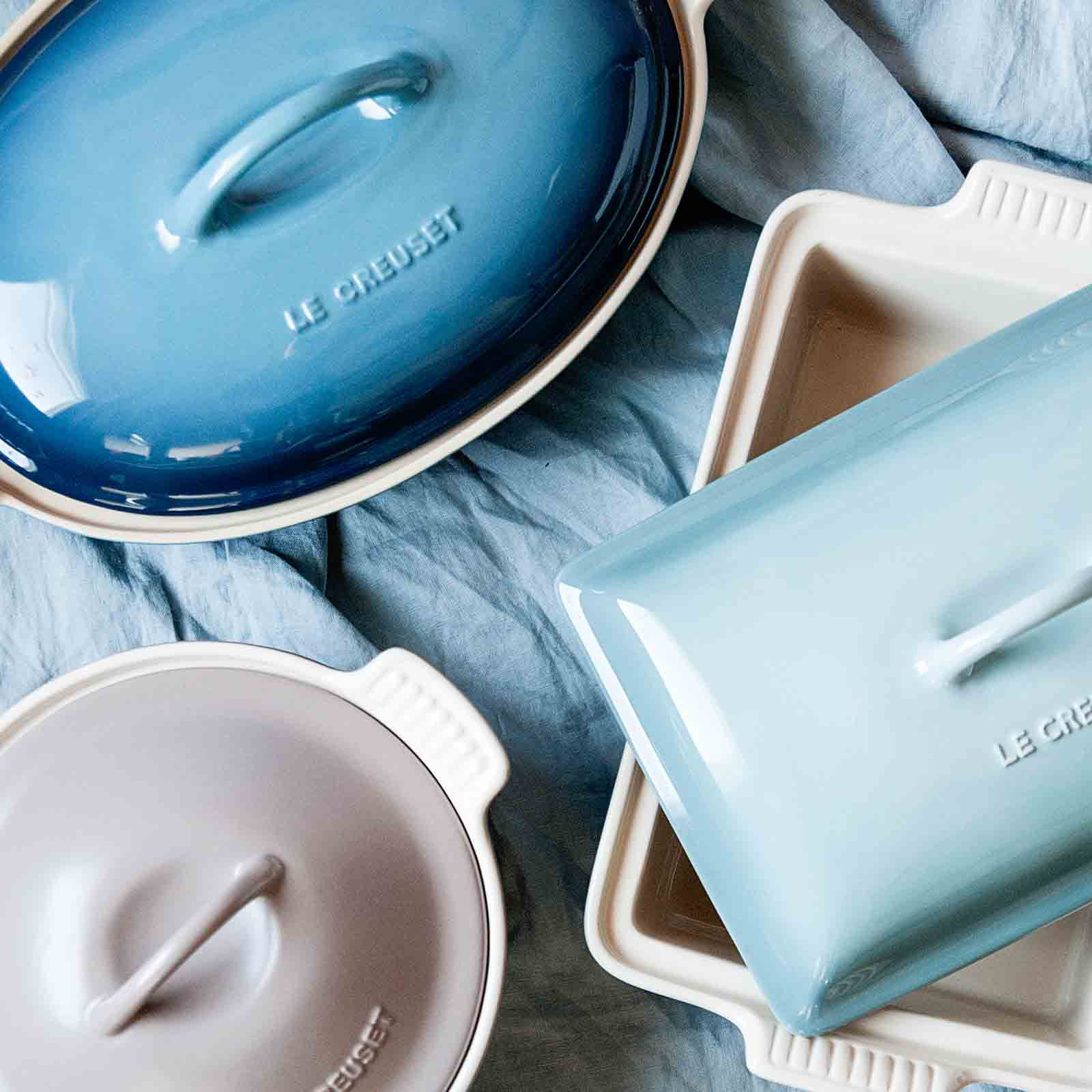 Overhead shot of stoneware dishes with lids