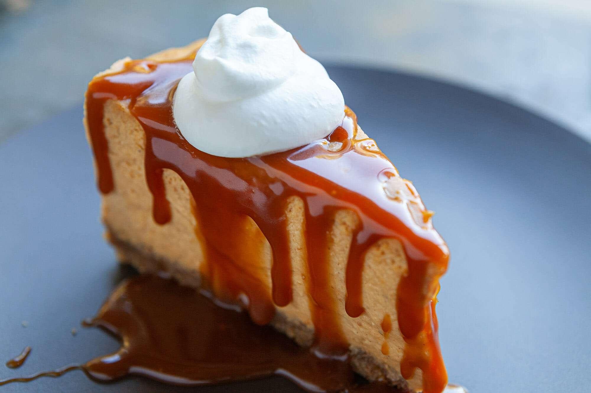 pumpkin cheesecake slice with whipped cream
