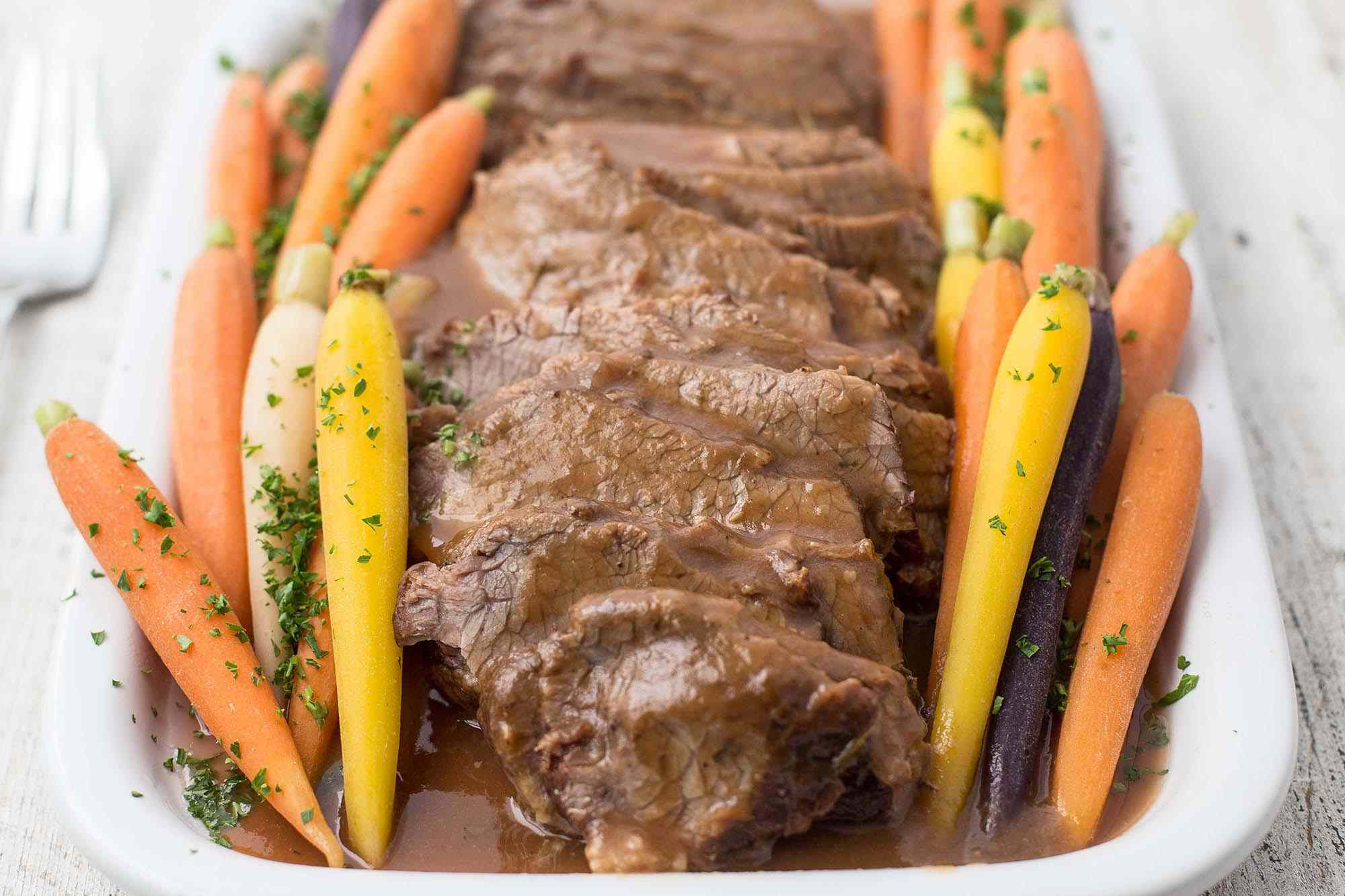Sliced Beef Brisket with sauce and carrots