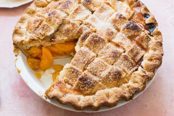 Best Peach Pie with a lattice crust and one slice removed