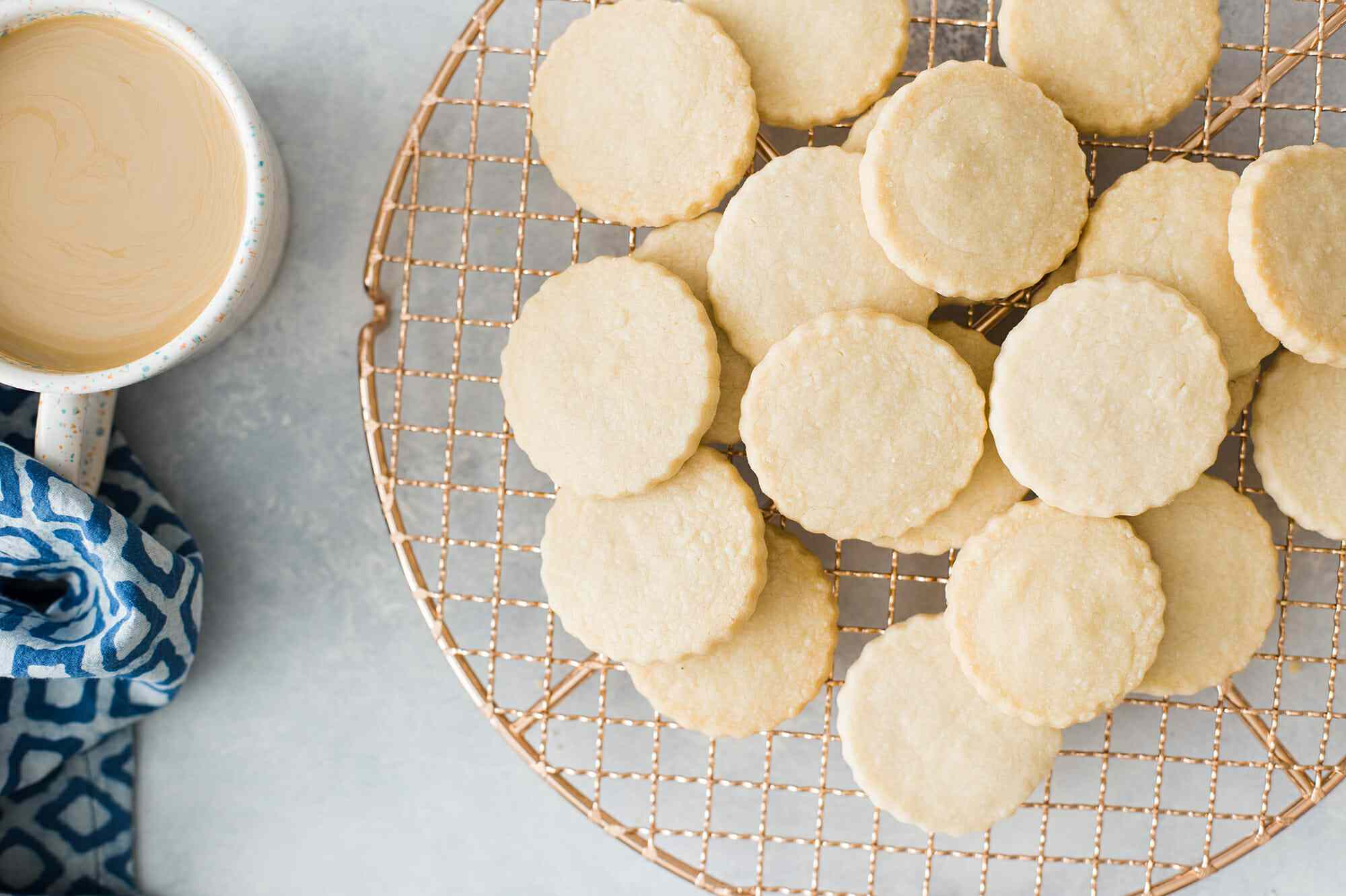 Round shortbread cookies on a cooling rack