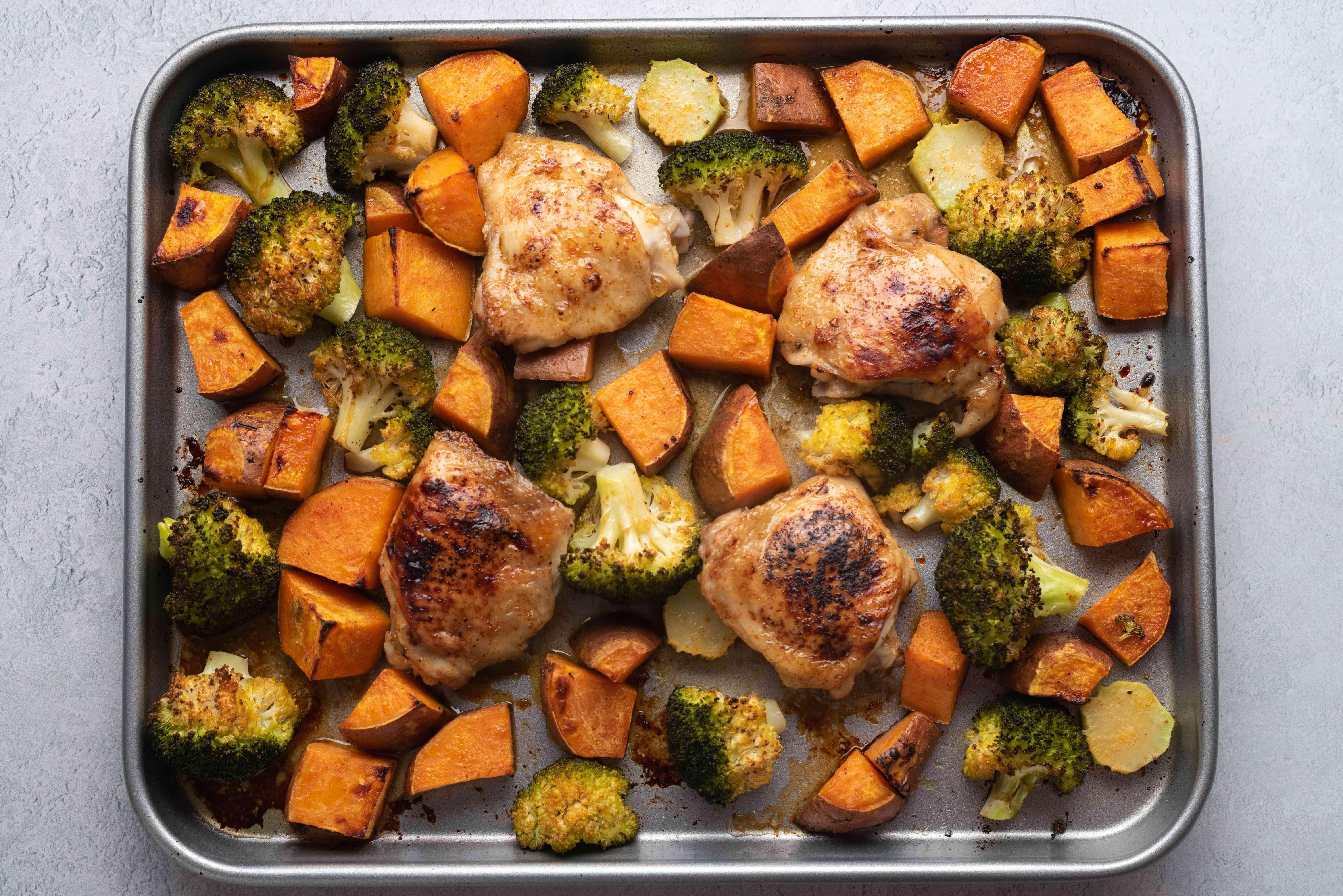 Roasted Sheet Pan Chicken, Sweet Potatoes, and Broccoli on a sheet pan