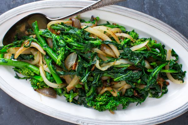 Broccoli Rabe and onions served on a platter.