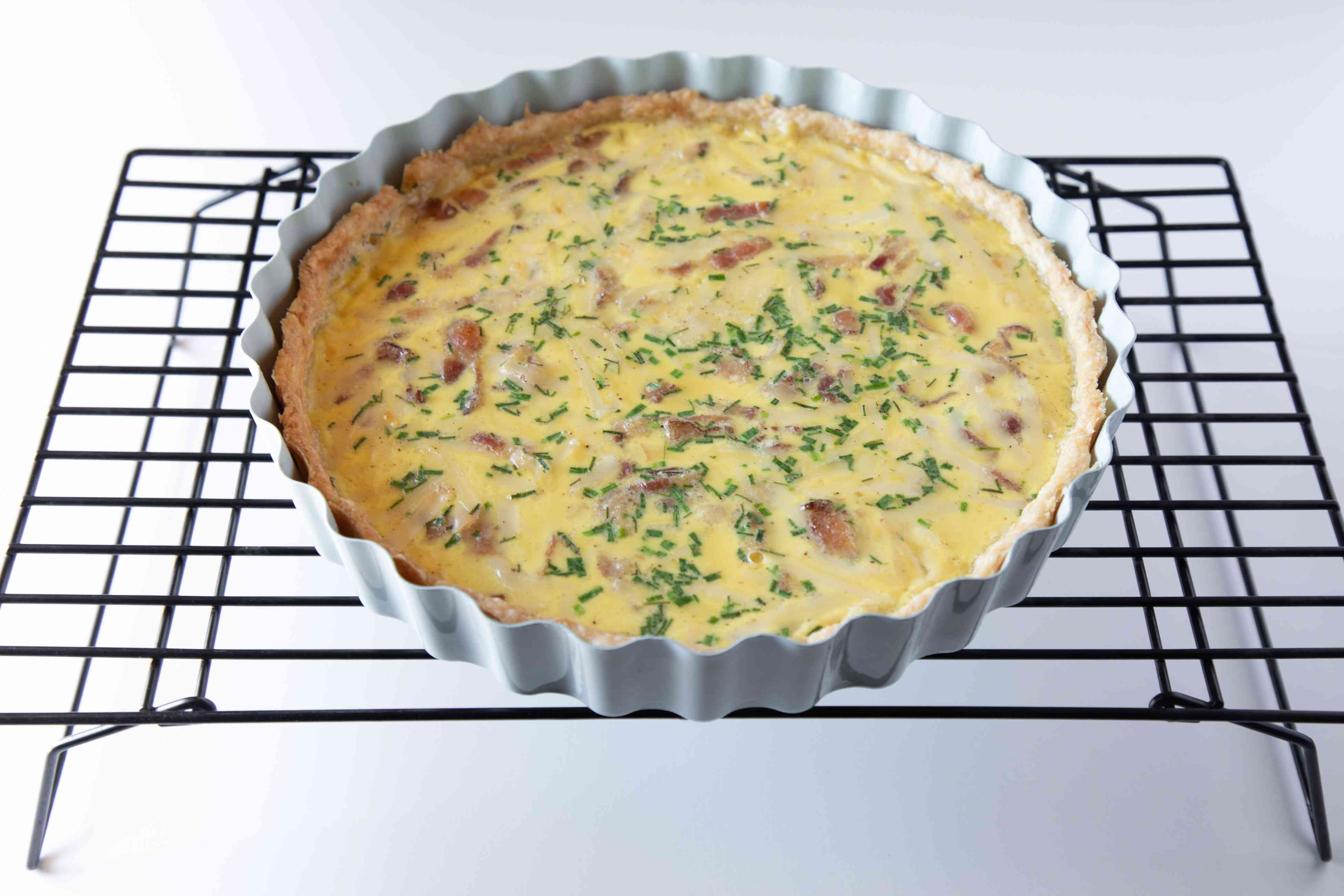 An easy quiche recipe cooling on a rack.