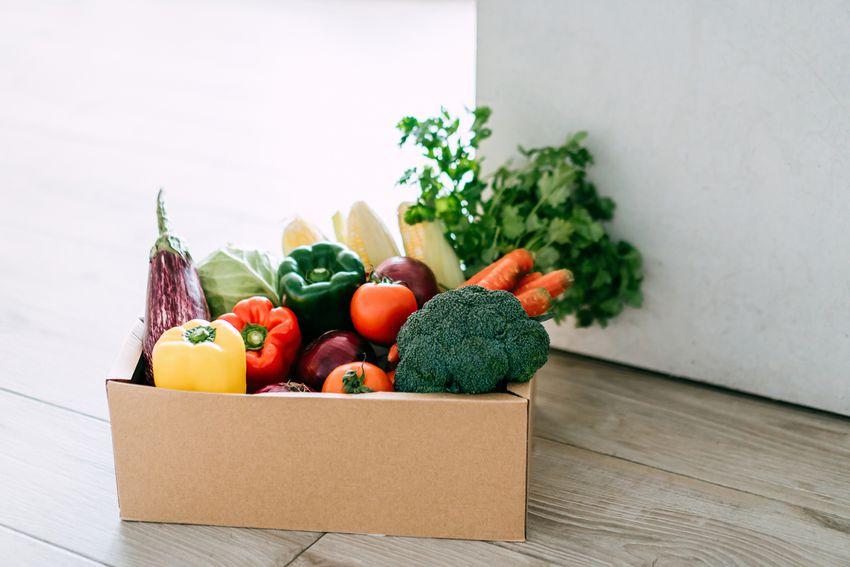 a box of fresh produce on a floor