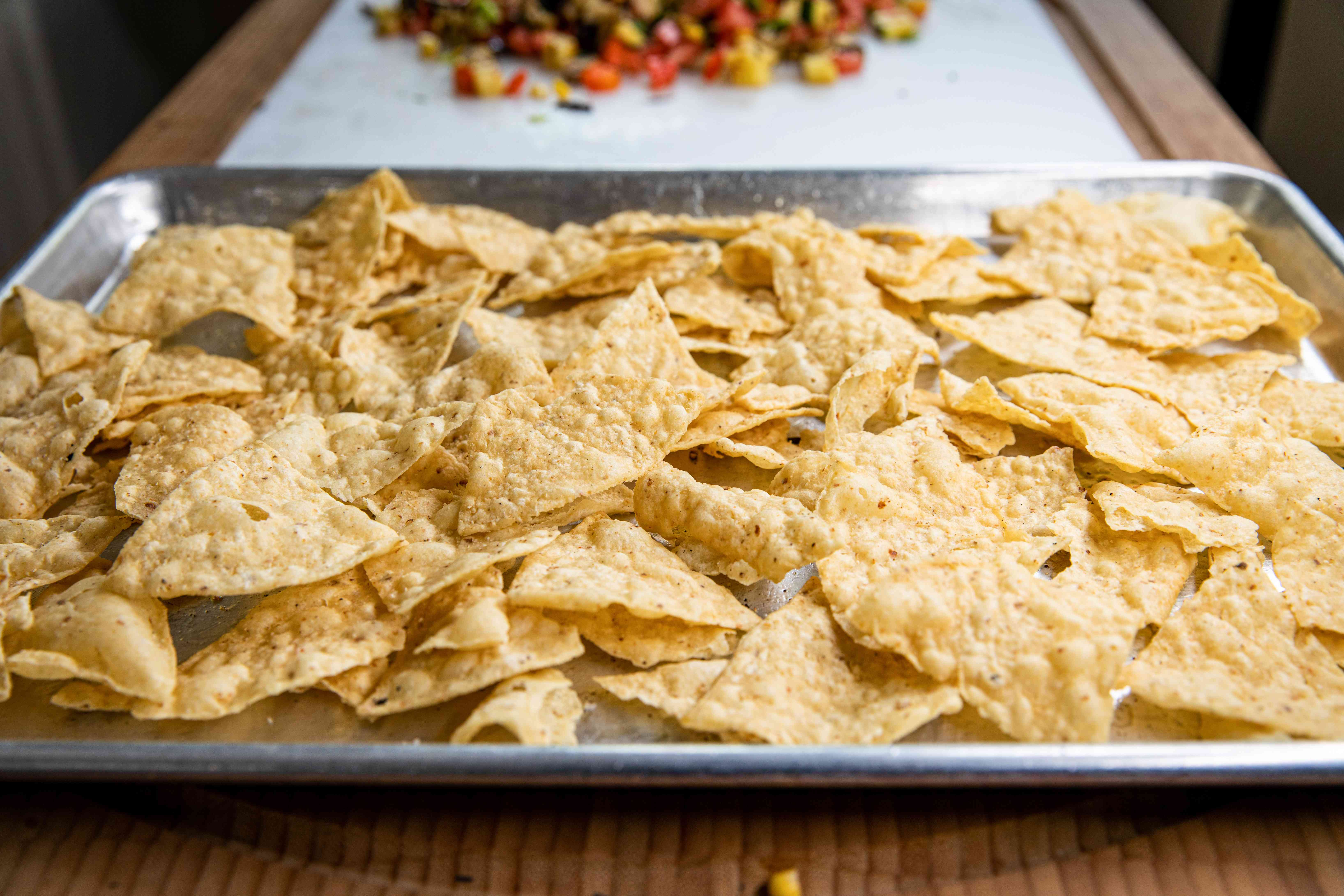 Chips on a baking sheet to make grilled vegetable nachos.