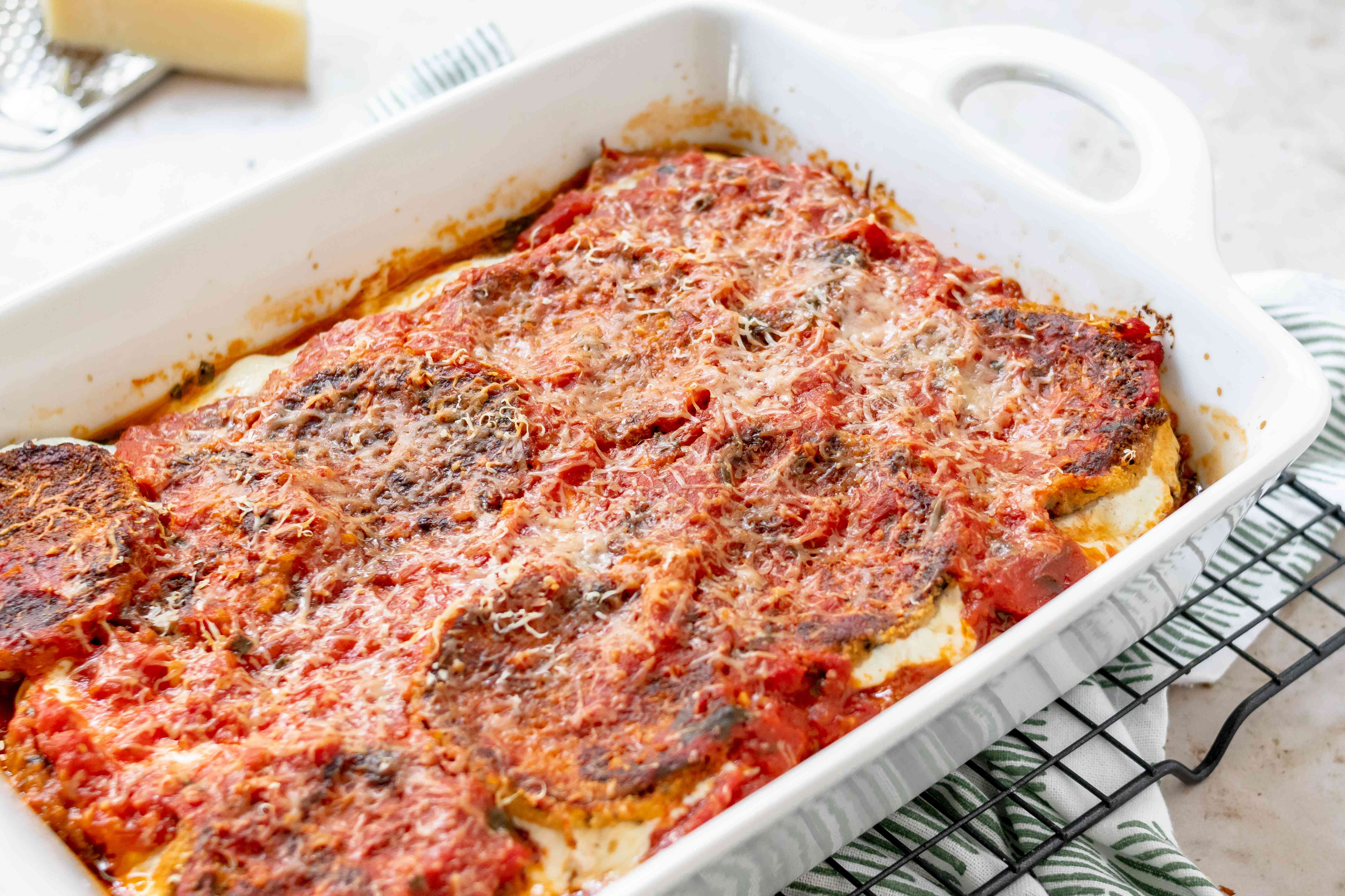 Baked eggplant parmesan in a casserole dish.