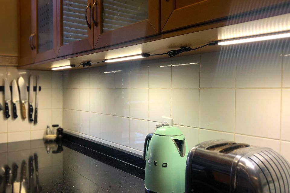under cabinet kitchen lighting with green smeg water kettle
