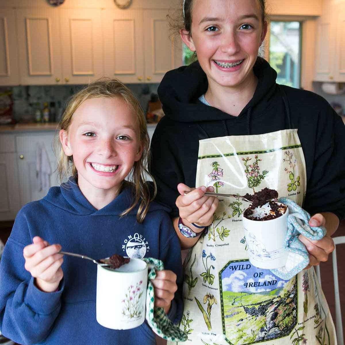 Piper and Alden eating mug brownies