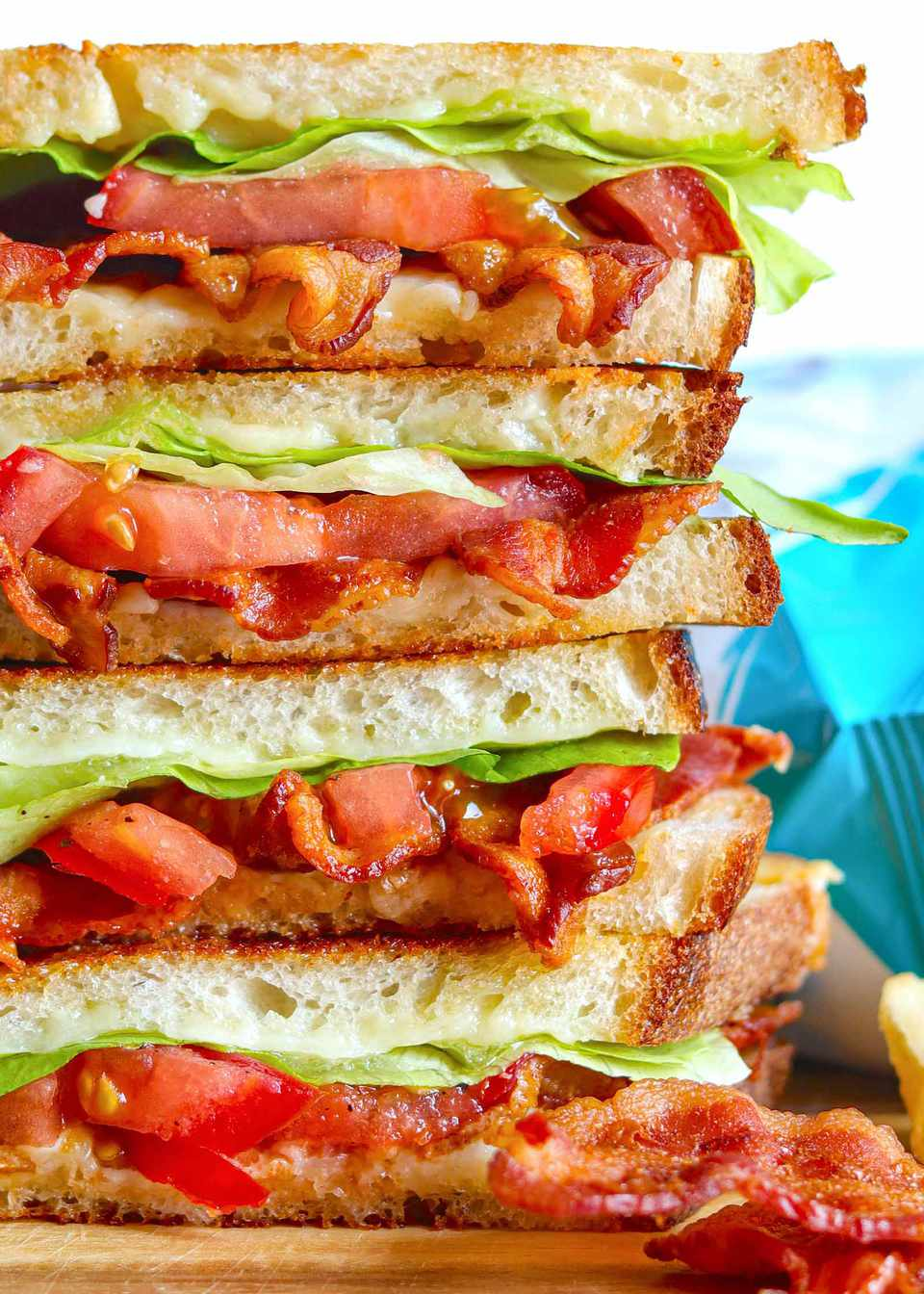 Closeup of crispy bacon, lettuce, and tomato on toasted grilled cheese bread