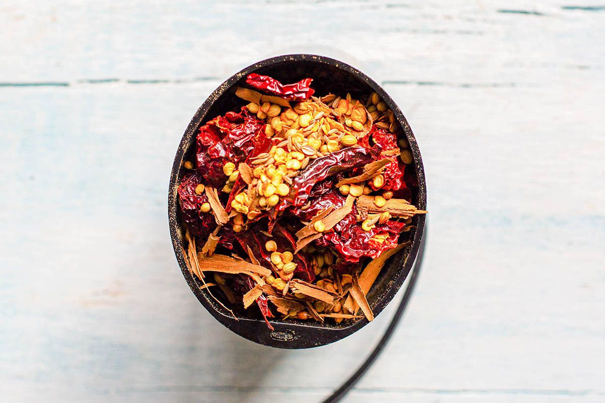 Dried red peppers in a small black bowl.