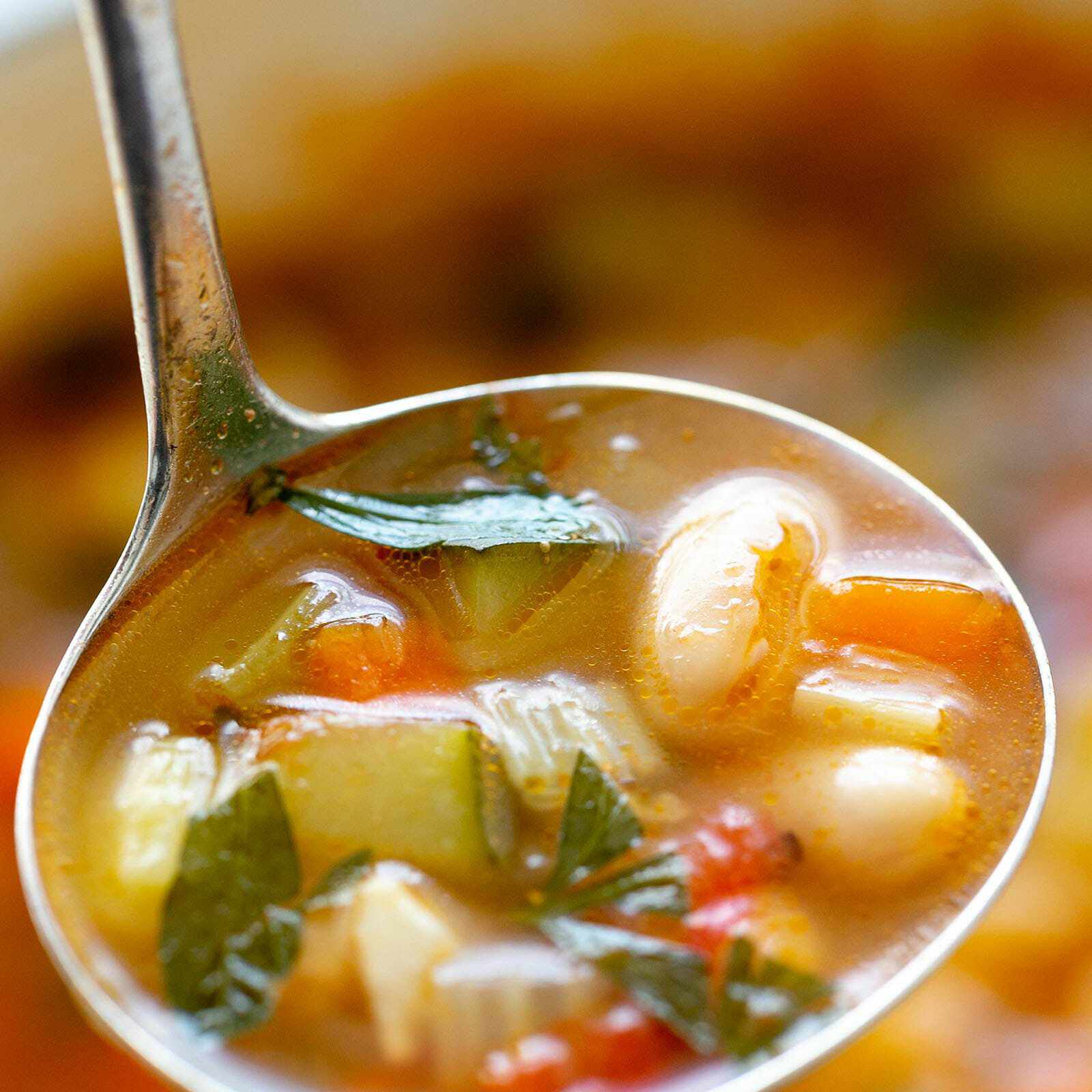 minestrone soup in ladle
