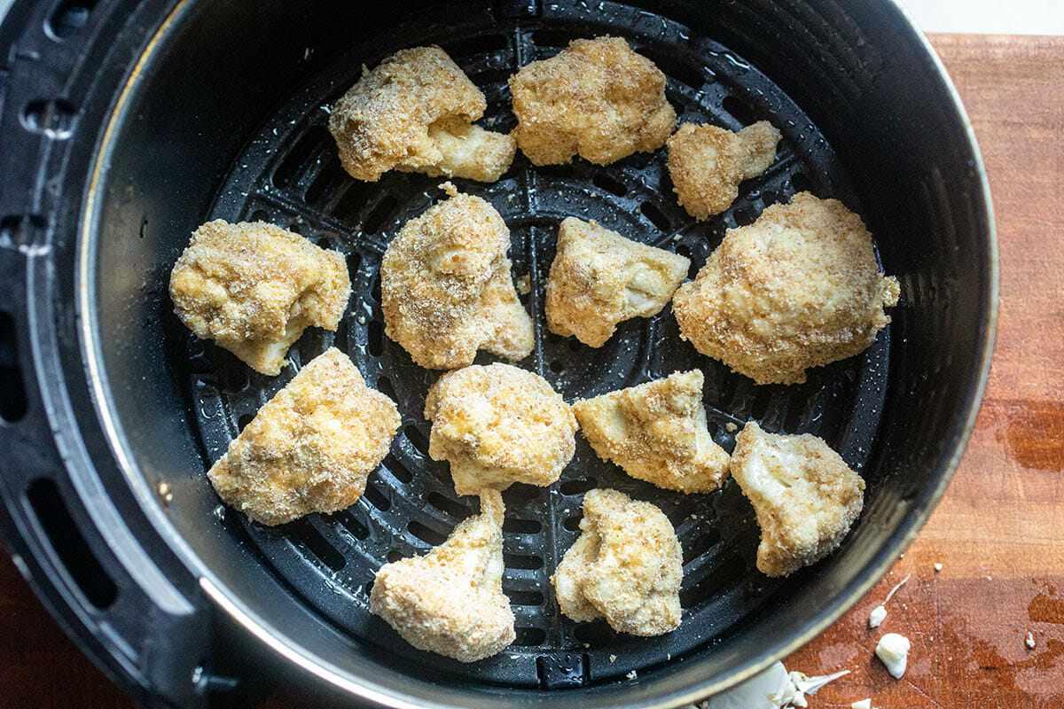 Buffalo Cauliflower without sauce and inside an air fryer.
