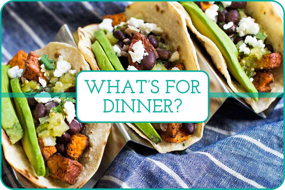 Three Sweet Potato and Black Bean Tacos with sliced avocado and crumbled cheese on top.