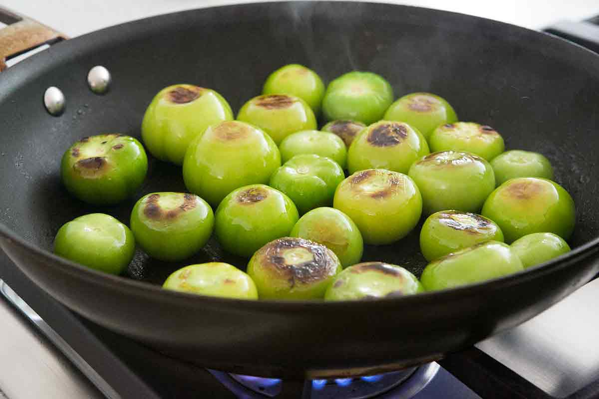 brown the tomatillos in a skillet for salsa verde