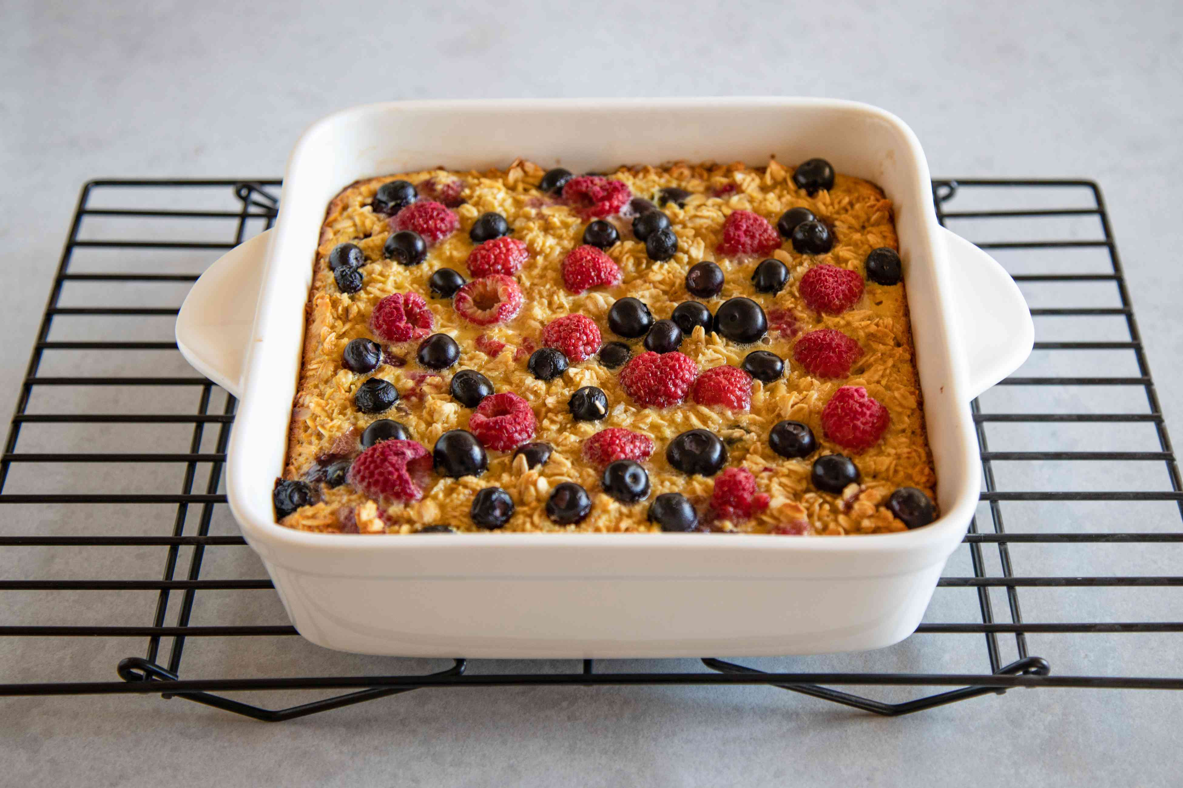 Mixed Berry Baked Oatmeal (Gluten-Free) cooling on a wire rack.