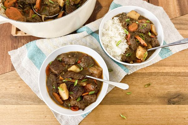 Two bowls of Jamaican Beef Stew served with rice.