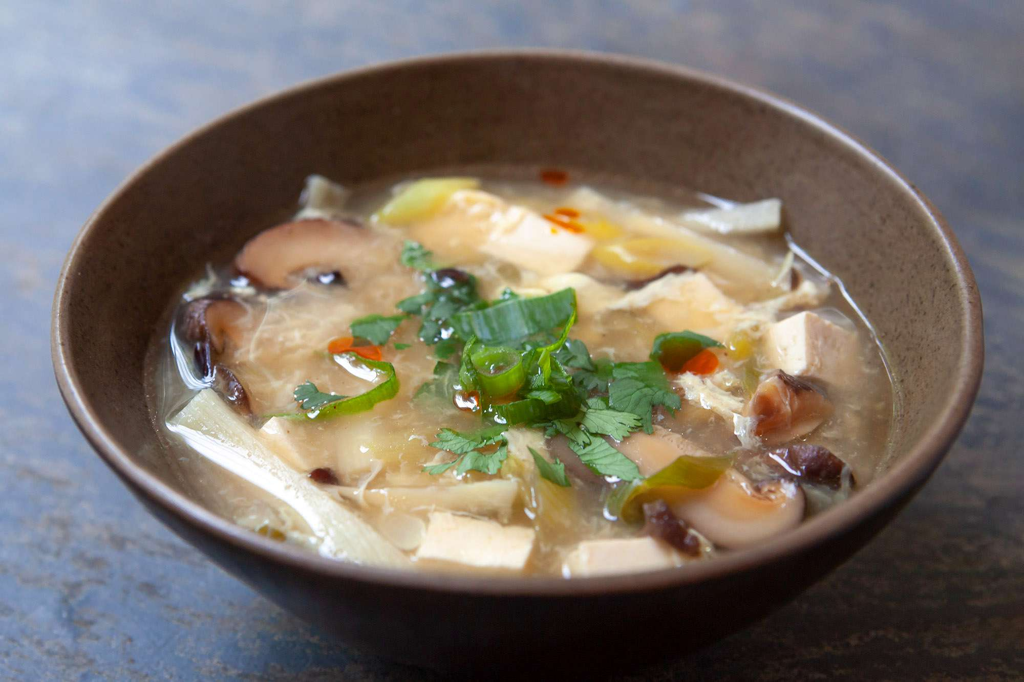 Sweet and sour soup in a bowl.